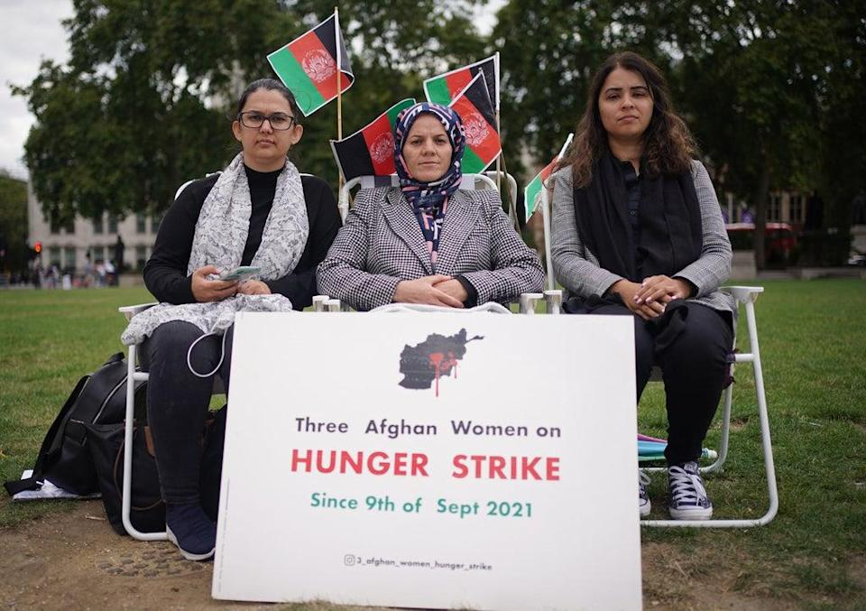 Three Afghan mothers (names withheld) who have been on hunger strike since Thursday September 9 – in protest against the Taliban takeover of Afghanistan – in Parliament Square (Yui Mok/PA) (PA Wire)