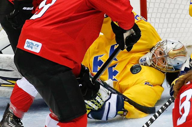 Goalkeeper Valentina Wallner of Sweden (35) blocks a shot on the goal during the second period of the of the women's bronze medal ice hockey game against Switzerland at the 2014 Winter Olympics, Thursday, Feb. 20, 2014, in Sochi, Russia. (AP Photo/Petr David Josek)