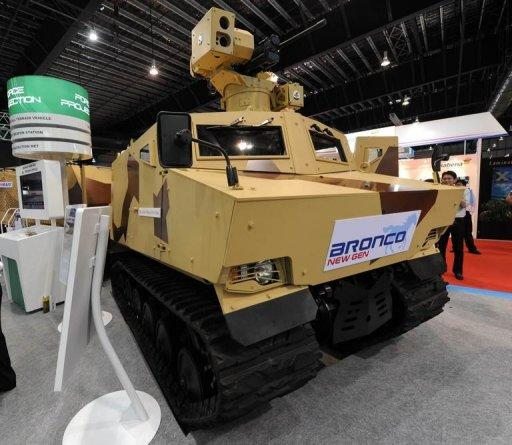 A Bronco New Gen All Terrain Vehicle manufactured by ST Kinetics is displayed at the Singapore Airshow, in February 2012. Singapore, better known for its clean-cut image and electronics exports, is seeking a place in the global arms industry by exploiting technological expertise honed on its own amply funded military