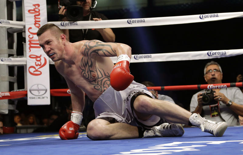 Tamas Kovacs falls after a hit from Beibut Shumenov during their WBA Super World and IBA light heavyweight title fight, Saturday, Dec. 14, 2013, in San Antonio. (AP Photo/Eric Gay)