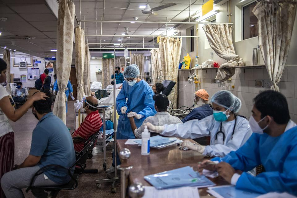 <p>Medical staff attend to Covid-19 patients at a hospital on 6 May, 2021 in New Delhi</p> (Getty Images)