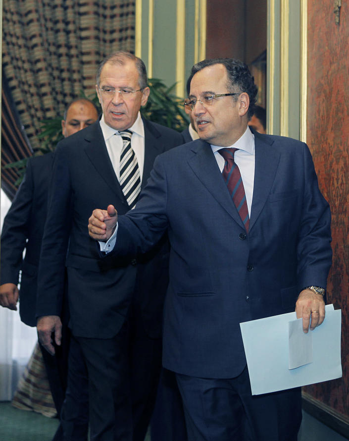 Egyptian foreign minister Nabil Fahmy, right, accompanies his Russian counterpart Sergei Lavrov following their meeting in Cairo, Egypt, Thursday, Nov. 14, 2013. Egypt's foreign minister said on Thursday that Russia was too important to be a substitute for the United States as Cairo's foreign ally and backer. (AP Photo/Amr Nabil)