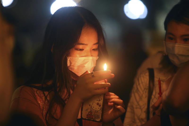 Hundreds of participants attend a candlelight vigil at Democracy Square in Taipei, Taiwan, Thursday, June 4, 2020, to mark the 31st anniversary of the Chinese military crackdown on the pro-democracy movement in Beijing's Tiananmen Square. (AP Photo/Chiang Ying-ying)
