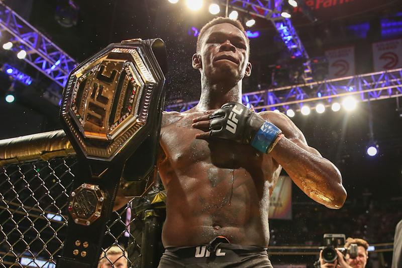 ATLANTA, GA - APRIL 13: Israel Adesanya holds up the belt after defeating Kelvin Gastelum by unanimous decision in their interim middleweight championship bout during the UFC 236 event at State Farm Arena on April 13, 2019 in Atlanta, Georgia. (Photo by Carmen Mandato/Zuffa LLC via Getty Images)