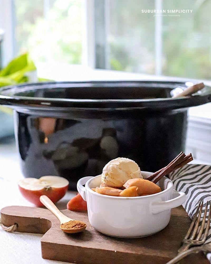 """<p>Serving a crowd? Don't stress about dessert—simply throw a bunch of apples into the slow cooker with warm spices, then top each serving with a heaping scoop of vanilla ice cream. </p><p><a href=""""https://www.suburbansimplicity.com/crockpot-apples/"""" rel=""""nofollow noopener"""" target=""""_blank"""" data-ylk=""""slk:Get the recipe"""" class=""""link rapid-noclick-resp"""">Get the recipe</a>.</p>"""