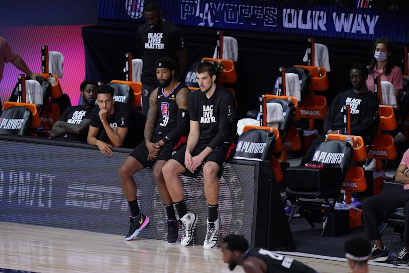 Clippers players sit on the bench during the second half of their Game 7 playoff loss to the Denver Nuggets.