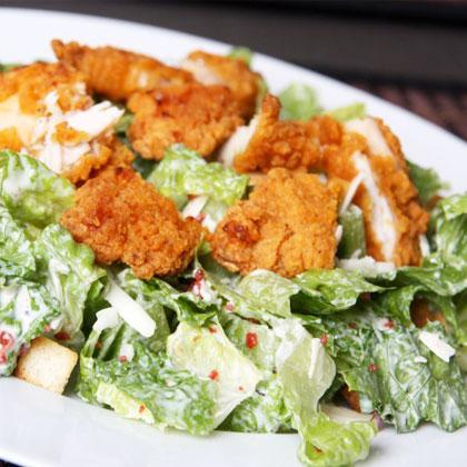 """<div class=""""caption-credit""""> Photo by: Thinkstock</div><div class=""""caption-title"""">Crispy Chicken Salad</div><b>Where You'll Find it:</b> Au Bon Pain, Ruby Tuesdays, McDonalds, KFC, Chick-fil-A <br> <br> <p>   <b>Why it's Worse:</b> Even before you add the salad dressing, which can clock in at 200 calories, this type of salad can easily reach 900-1000 calories due to the """"crispy"""" (read: fried) <a rel=""""nofollow"""" href=""""http://www.shape.com/healthy-eating/diet-tips/12-salads-worse-big-mac?page=2#"""">chicken</a> pieces. Add the creamy, cheese-packed dressing and the saturated fat can easily exceed 12 grams. </p>"""