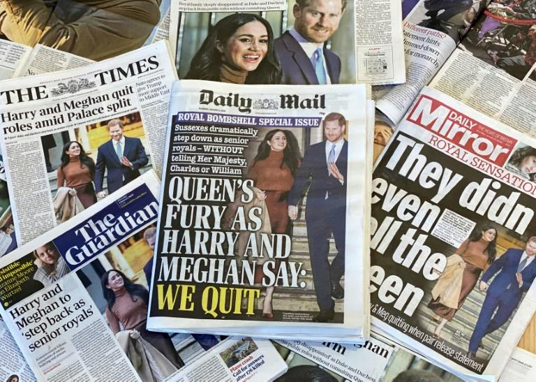 """An arrangement of UK daily newspapers photographed as an illustration in London on January 9, 2020, shows front page headlines reporting on the news that Britain's Prince Harry, Duke of Sussex and his wife Meghan, Duchess of Sussex, plan to step back as """"senior"""" members of the Royal Family.Prince Harry and his wife Meghan stunned the British monarchy on Wednesday by quitting as front-line members -- reportedly without first consulting Queen Elizabeth II. In a shock announcement, the couple said they would spend time in North America and rip up long-established relations with the press. Media reports said the Duke and Duchess of Sussex made their bombshell statement without notifying either Harry's grandmother the monarch, or his father Prince Charles"""