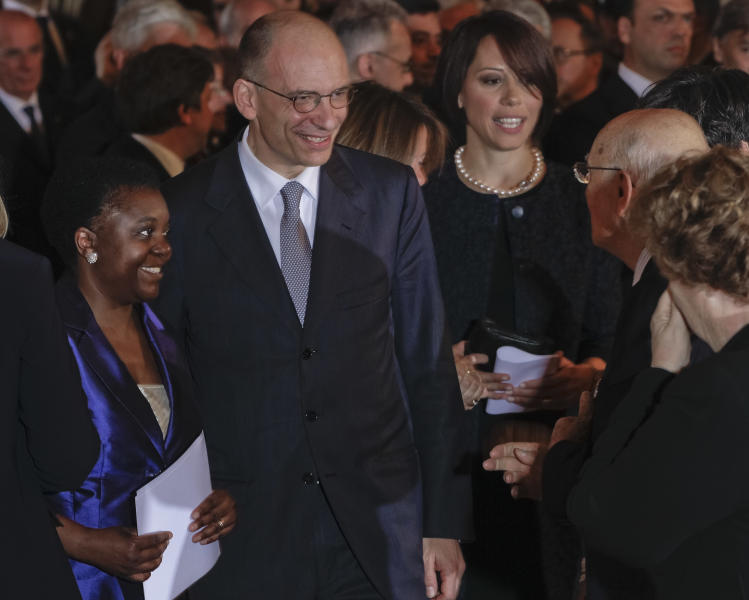 Italian Premier Enrico Letta, is flanked by Integration Minister Cecile Kyenge, left, and Agriculture Minister Nunzia De Girolamo, during the swearing in ceremony of the new government at the Quirinale Presidential Palace, in Rome, Sunday, April 28, 2013. (AP Photo/Domenico Stinellis)