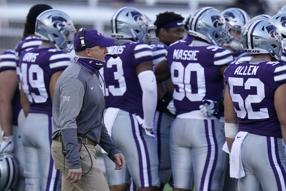Kansas State head coach Chris Klieman walks behind his team during a timeout in the first half of an NCAA college football game against Oklahoma State in Manhattan, Kan., Saturday, Nov. 7, 2020. (AP Photo/Orlin Wagner)