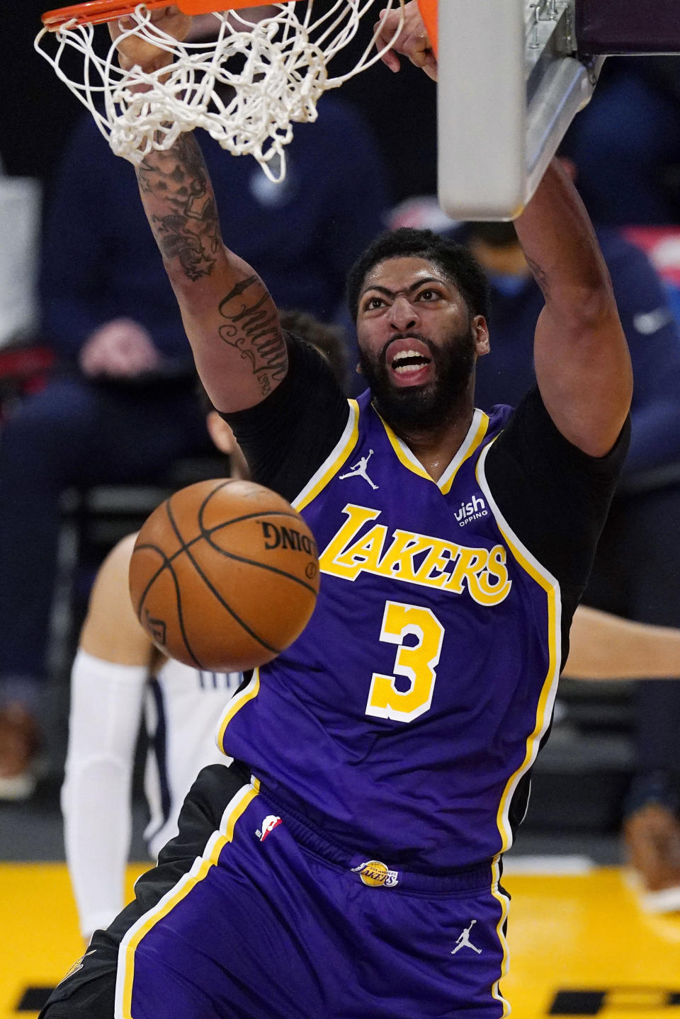 Los Angeles Lakers forward Anthony Davis dunks during the first half of the team's NBA basketball game against the Memphis Grizzlies on Friday, Feb. 12, 2021, in Los Angeles. (AP Photo/Mark J. Terrill)