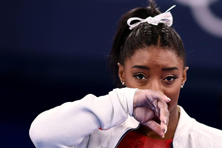 USA's Simone Biles gestures after withdrawing from the team gymnastics final citing mental health concerns