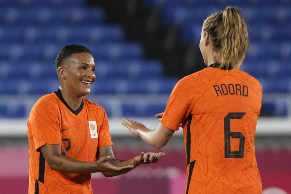 Netherlands' Shanice van de Sanden, left, celebrates with Jill Roord after scoring a goal during a women's soccer match against China at the 2020 Summer Olympics, Tuesday, July 27, 2021, in Yokohama, Japan. (AP Photo/Kiichiro Sato)