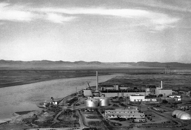 In this undated photo, the Columbia River flows next to the Hanford Atomic Plant in Richland, Wash. The federal government created Hanford at the height of World War II, moving 50,000 people near the Washington-Oregon border for a top-secret construction project. The influx quickly made this area Washington's fourth-largest city, but most workers didn't even know exactly what they were building - the world's first full-scale nuclear reactor - until the bomb was dropped on Nagasaki. (AP Photo)