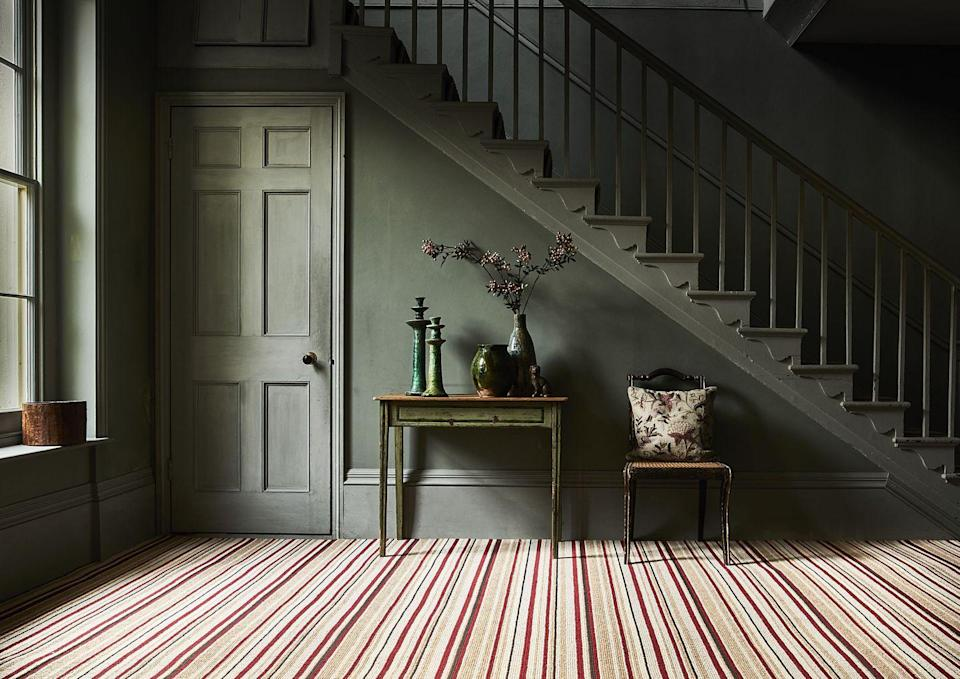 """<p>Make a feature of your patterned carpet by choosing a bold mix of warm colours, and limiting the colour palette in the rest of your room to cooler shades. The deep green here is the perfect complement to the warmer reds and oranges in this Carpetright striped carpet. </p><p>Pictured: <a href=""""https://www.carpetright.co.uk/carpets/residence-striped-carpet/"""" rel=""""nofollow noopener"""" target=""""_blank"""" data-ylk=""""slk:Residence Striped Carpet at Carpetright"""" class=""""link rapid-noclick-resp"""">Residence Striped Carpet at Carpetright</a></p>"""