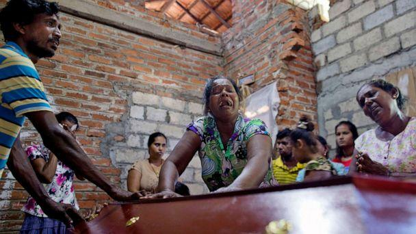 PHOTO: Lalitha, center, weeps beside the coffin with the remains of a a victim of Easter Sunday bombing at St. Sebastian Church, after it returning home in Negombo, Sri Lanka, April 22, 2019. (Gemunu Amarasinghe/AP)