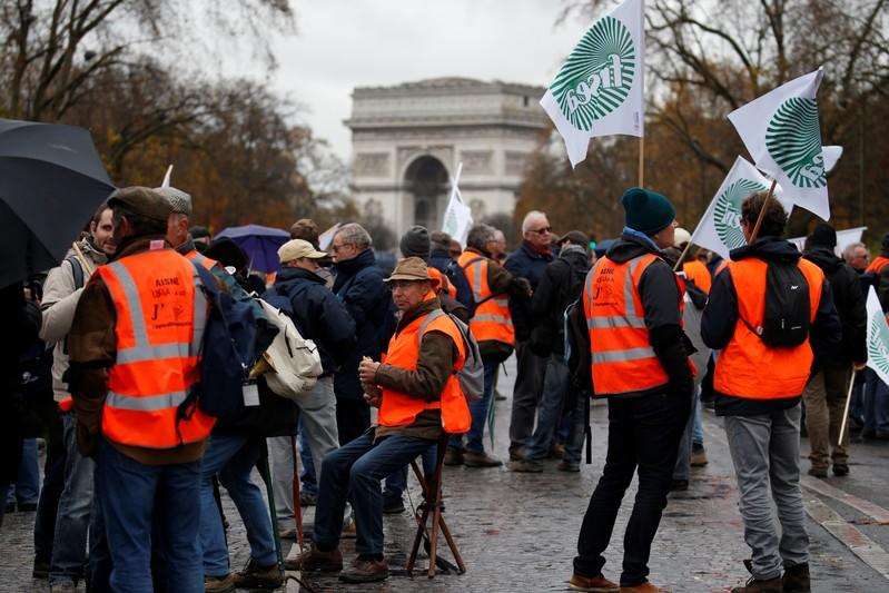 French farmers gather near the Arc de Triomphe during a day of protest in Paris