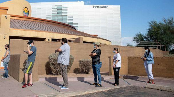 PHOTO: In this Nov. 3, 2020, file photo, voters wait to cast their ballots at Marquee Theatre in Tempe, Arizona. (Courtney Pedroza/Getty Images, FILE)