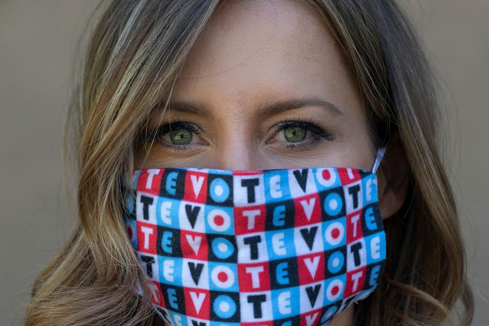 "Amber McReynolds wearing a mask that says ""vote"" on Sept. 29, 2020.<span class=""copyright"">Rachel Woolf for TIME</span>"