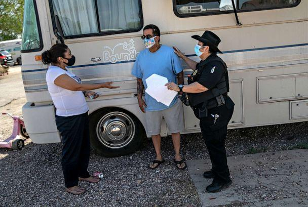 PHOTO: Maricopa County constable Darlene Martinez brokers a deal between delinquent renter Hector Medrano and property manager Teodora Carcia at an RV park on Oct. 07, 2020, in Phoenix. (John Moore/Getty Images)