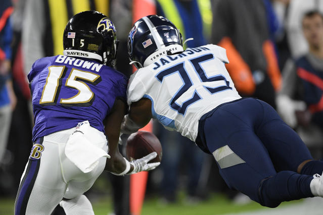 Baltimore Ravens wide receiver Marquise Brown (15) works for a catch against Tennessee Titans cornerback Adoree' Jackson (25) during the first half an NFL divisional playoff football game, Saturday, Jan. 11, 2020, in Baltimore. (AP Photo/Nick Wass)