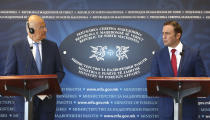 Greek Foreign Minister Nikos Dendias, left and North Macedonia's Foreign Minister Bujar Osmani, right, hold a joint news conference after their meeting at the foreign ministry in Skopje, North Macedonia, Tuesday, Aug. 31, 2021. Ministers of foreign affairs of Greece and North Macedonia agreed that bilateral relations are improving continuously in all spheres, after both countries signed a deal that changed Macedonia's name three years ago. (AP Photo/Boris Grdanoski)