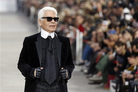 German designer Karl Lagerfeld appears at the end of his Spring/Summer 2014 women's ready-to-wear fashion show for French fashion house Chanel during Paris fashion week