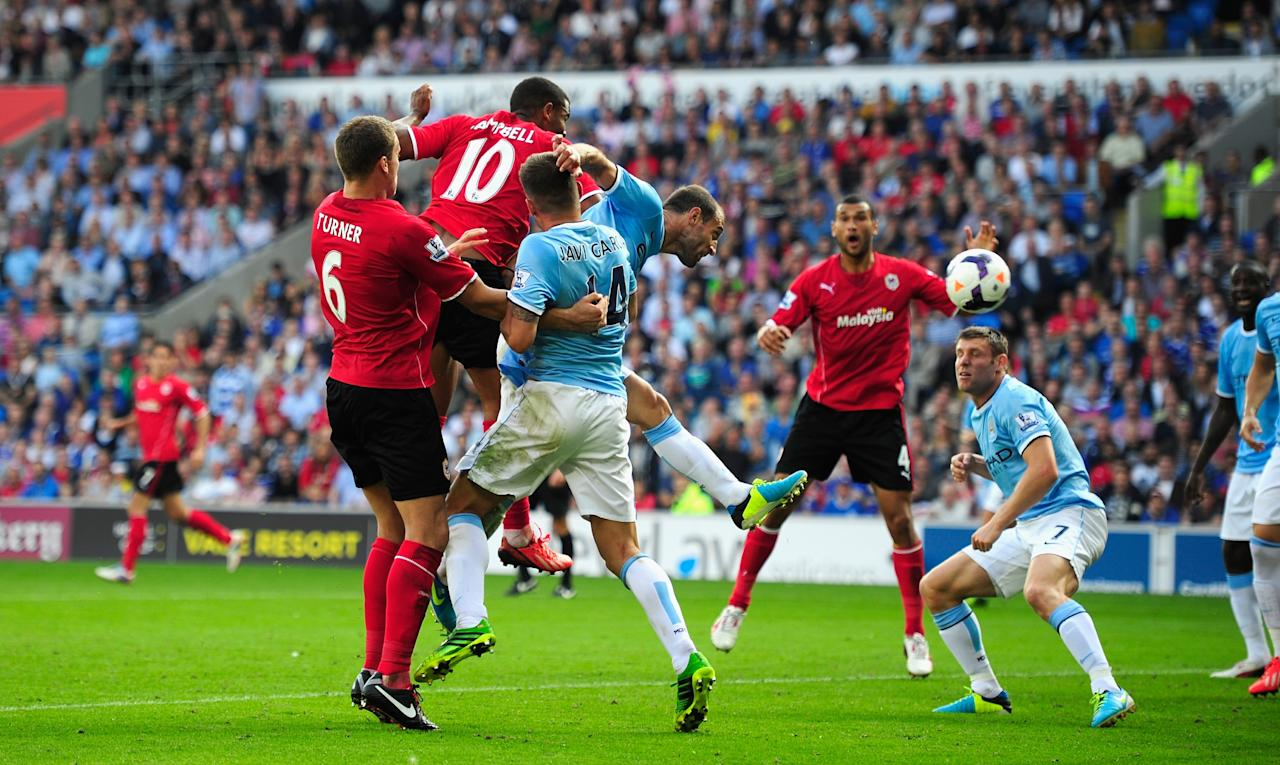 CARDIFF, WALES - AUGUST 25: Cardiff City player Fraizer Campbell (10) heads in the third Cardiff goal during the Barclays Premier League match between Cardiff City and Manchester City at Cardiff City Stadium on August 25, 2013 in Cardiff, Wales. (Photo by Stu Forster/Getty Images)