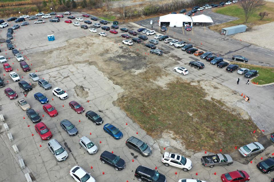 In this drone image, residents in cars wait in line at a drive-up COVID-19 test site in Aurora, Illinois.