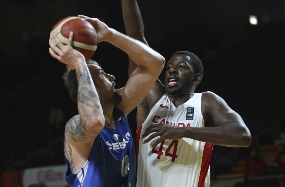 Canada's Andrew Nicholson, right, tries to block Czech Republic's Ondrej Balvin during the first half of a FIBA men's Olympic basketball qualifying semifinal at Memorial Arena in Victoria, British Columbia, Saturday, July 3, 2021. (Chad Hipolito/The Canadian Press via AP)