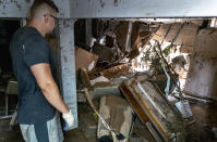Simon Wolyniec stands in the basement of his Manville, N.J., home Sunday, Sept. 5, 2021, in the wake of Hurricane Ida. Wolyniec said that the basement wall collapsed in the early hours of Sept. 2, and shortly thereafter, with the aid of a kayak for his children, he and his family waded into the deep water already inundating the first floor, to safety. (AP Photo/Craig Ruttle)