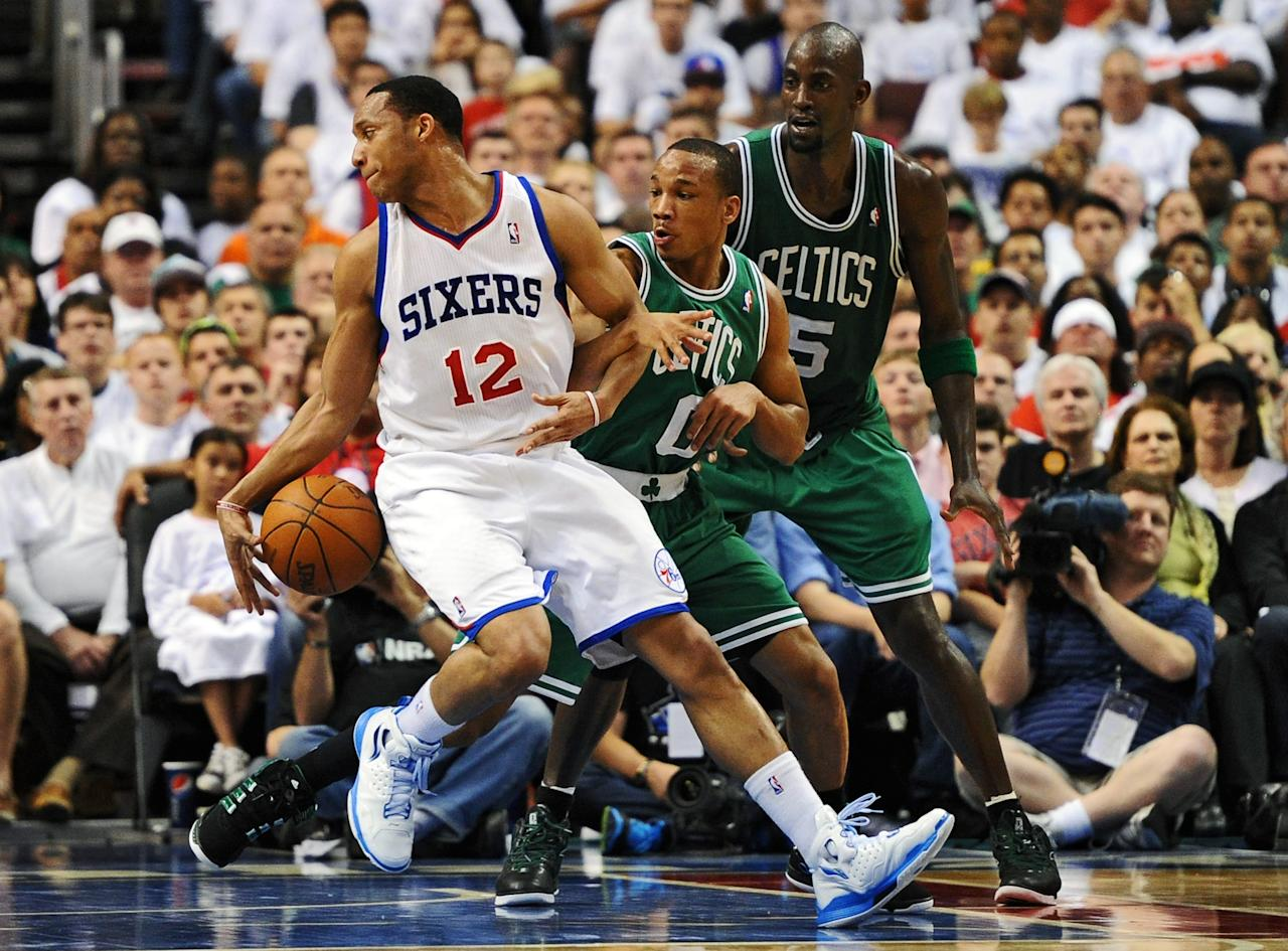 PHILADELPHIA, PA - MAY 18: Evan Turner #12 of the Philadelphia 76ers tries to spin around Avery Bradley #0 and Kevin Garnett #5 of the Boston Celtics in Game Four of the Eastern Conference Semifinals in the 2012 NBA Playoffs at the Wells Fargo Center on May 18, 2012 in Philadelphia, Pennsylvania. NOTE TO USER: User expressly acknowledges and agrees that, by downloading and or using this photograph, User is consenting to the terms and conditions of the Getty Images License Agreement. (Photo by Drew Hallowell/Getty Images)