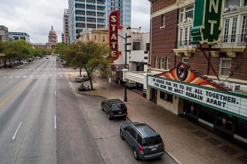 Congress Avenue in Austin, Texas, is devoid of its usual heavy traffic in this photo taken around 11:30 a.m. on March 17, 2020, amid the coronavirus outbreak. A hopeful message is on the marquee at the Paramount Theatre.