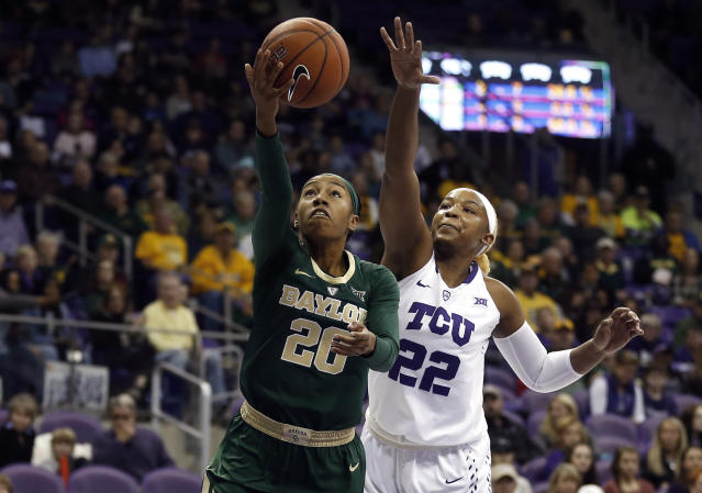 Baylor guard Juicy Landrum (20) drives inside for a shot as TCU center Jordan Moore (22) defends during the first half of an NCAA college basketball game Saturday, Jan. 12, 2019, in Fort Worth, Texas. (AP Photo/Ron Jenkins)