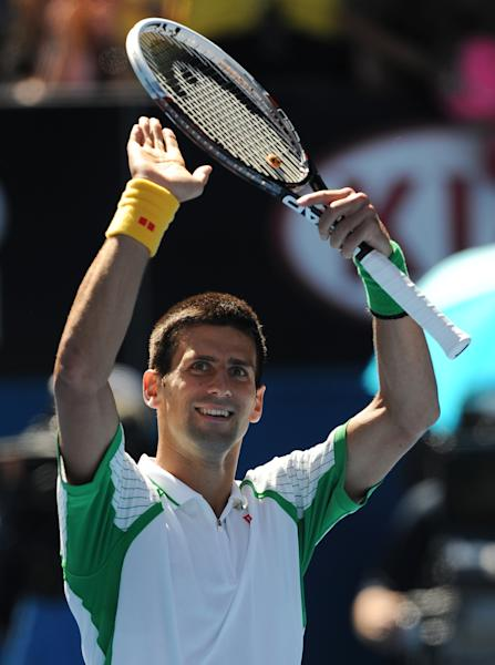 Serbia's Novak Djokovic celebrates after his first round win over France's Paul-Henri Mathieu at the Australian Open tennis championship in Melbourne, Australia, Monday, Jan. 14, 2013. (AP Photo/Andrew Brownbill)