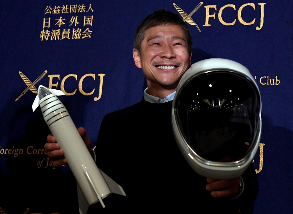 Yusaku Maezawa, entrepreneur and CEO of ZOZOTOWN and SpaceX BFR's first private passenger, poses with a miniature rocket and space helmet prior to start of a press conference at the Foreign Correspondents' Club of Japan in Tokyo on October 9, 2018.  Photo: TOSHIFUMI KITAMURA/AFP via Getty Images