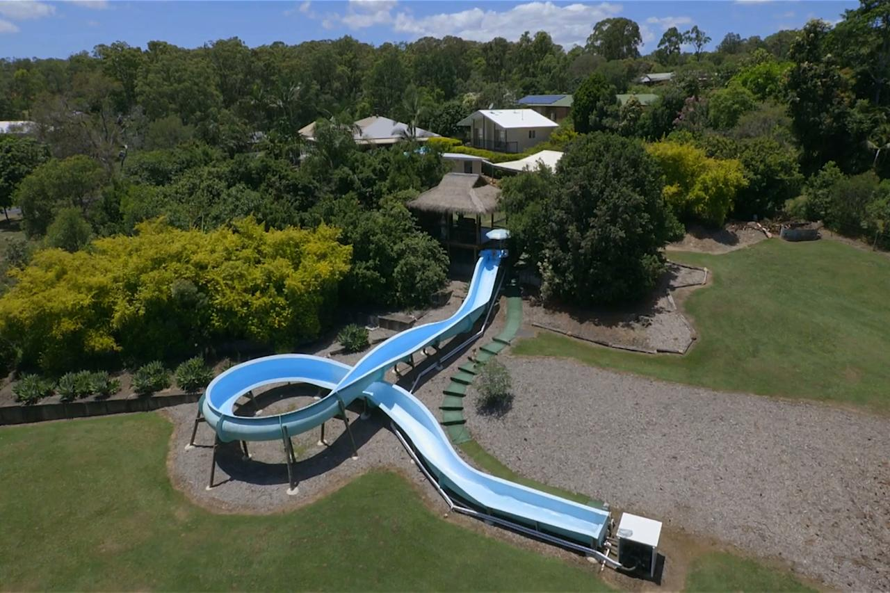 <p>The mega 164ft-long slide snakes its way through the gardens of the sprawling mansion in the northern suburbs of Brisbane. The property is on the market for A$1.075m – that's about £614,000, less than the price of an average house in London. </p>
