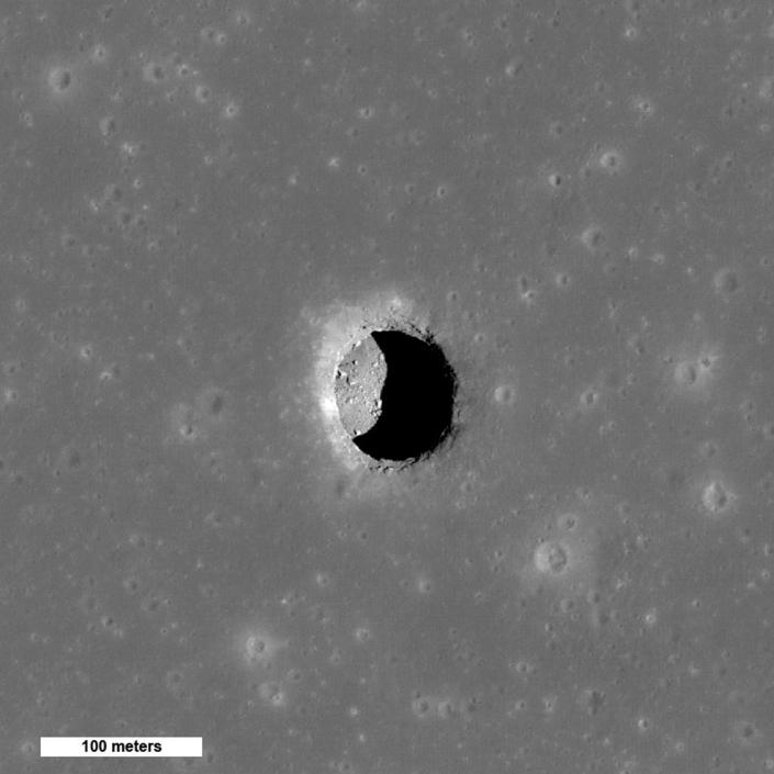 Boulders on an otherwise smooth floor are seen on the Mare Tranquillitatis pit crater on the surface of the Moon in this NASA image taken by the NASA's Lunar Reconnaissance Orbiter and released September 14, 2010. When the Sun is well overhead, the floor of the Mare Tranquillitatis pit is illuminated. Scientists estimate the depth to be a bit over 100 meters. REUTERS