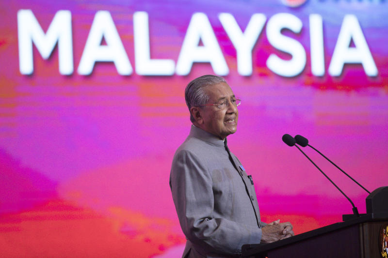 In this May 9, 2019, photo, Malaysian Prime Minister Mahathir Mohamad, speaks during a press conference in Putrajaya, Malaysia. Malaysian Prime Minister Mahathir has tendered his resignation to the king, his office reported Monday. (AP Photo/Vincent Thian)