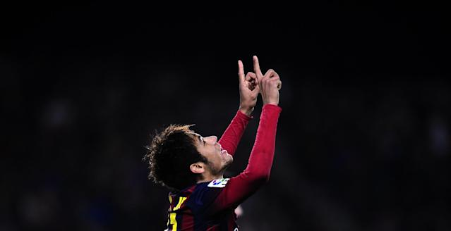FC Barcelona's Neymar, from Brazil, reacts after scoring against Cartagena during a Copa del Rey soccer match at the Camp Nou stadium in Barcelona, Spain, Tuesday, Dec. 17, 2013. (AP Photo/Manu Fernandez)