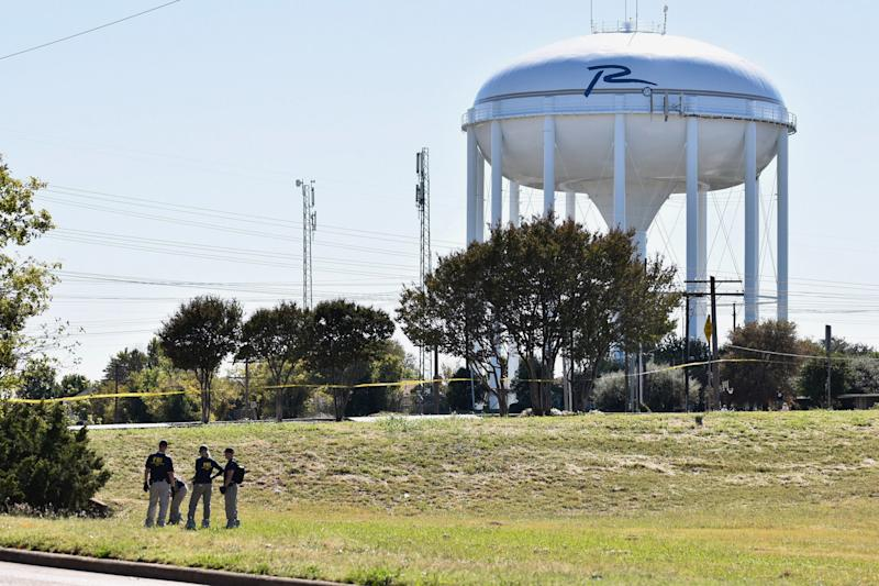 FBI investigators search a grassy area near a ditch where a child's body was found, as the search continued for a missing girl in Richardson, Texas, on Oct. 22, 2017.