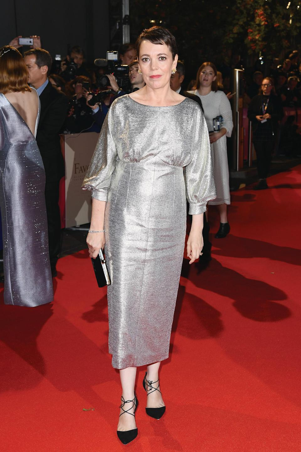 <p>Much like her co-star Emma Stone, Olivia opted to wear a shimmery, silver dress for her film's premiere at London Film Festival. But while Emma opted for Louis Vuitton, Olivia stayed true to her British roots in a dress by London Fashion Week designer Emilia Wickstead. <em>[Photo: Getty for the BFI]</em> </p>