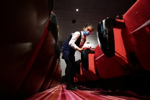 Business, like cinemas in China, are reopening, but with virus restrictions