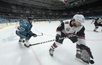Arizona Coyotes right wing Phil Kessel (81) works for the puck against San Jose Sharks defenseman Marc-Edouard Vlasic (44) during the second period of an NHL hockey game Friday, May 7, 2021, in San Jose, Calif. (AP Photo/Tony Avelar)