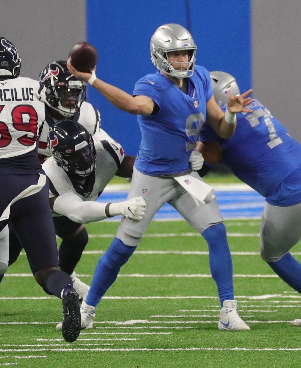 Lions quarterback Matthew Stafford passes against the Texans during the first half at Ford Field on Thursday, Nov  26, 2020.