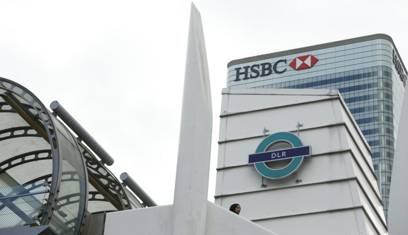 A general view of the headquarters of the banking giant HSBC, with the Poplar Dockland Light Railway station in front, at Canary Wharf in London Monday, Feb. 15, 2016. HSBC Holdings plc said late Sunday that it will keep its headquarters in London, ending a months long process in which one of the world's largest financial companies considered moving to Hong Kong to get closer to its centre of gravity in fast-growing Asian economies. The bank launched the review last April in light of regulatory and tax changes implemented by the U.K. after the 2008 financial crisis.(AP Photo/Alastair Grant)