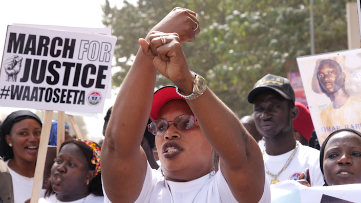 A relative of one of the victims of the regime of Yahya Jammeh gestures during a demonstration asking for the former Gambian president to be brought to justice - Banjul, 25 January 2020