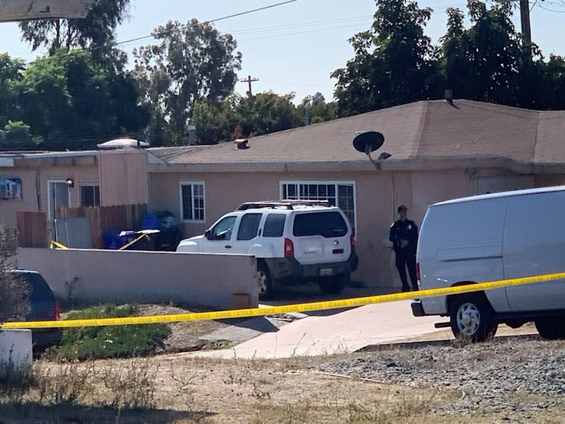 Pictured is police tape outside the San Diego home where five people were shot in an apparent murder-suicide.