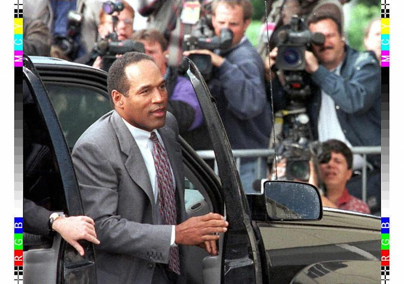 OJ Simpson is seen on November 22, 1996 arriving at a Santa Monica, California courthouse for the wrongful death lawsuit brought by the families of his murdered ex-wife and her friend