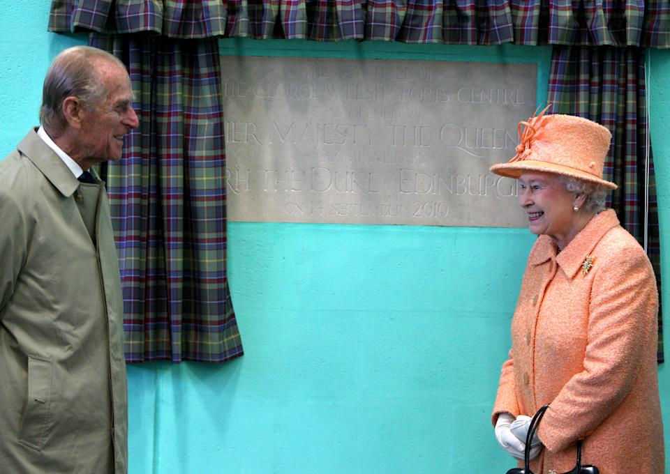 ELGIN, SCOTLAND - SEPTEMBER 14:  Queen Elizabeth II and Prince Philip, Duke of Edinburgh unveil a plaque during a visit to Gordonstoun School to open a new sports hall on September 14, 2010 in Elgin, United Kingdom. (Photo by Anwar Hussein/Getty Images)